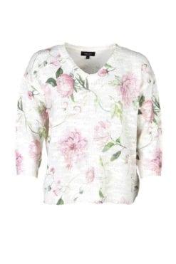 Topp Flora är en vårig tröja med vackert print av blommor på en vit botten. V-formad halsringning med ribbade detaljer vid ärmslut och nederkant.