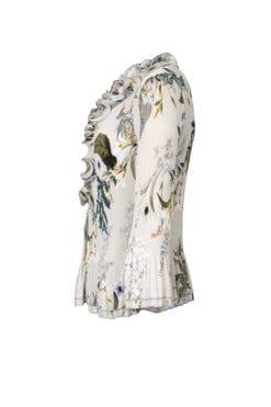 Blus Silvana Vacker plisserad blus i ett beige och grönt print med blommor.